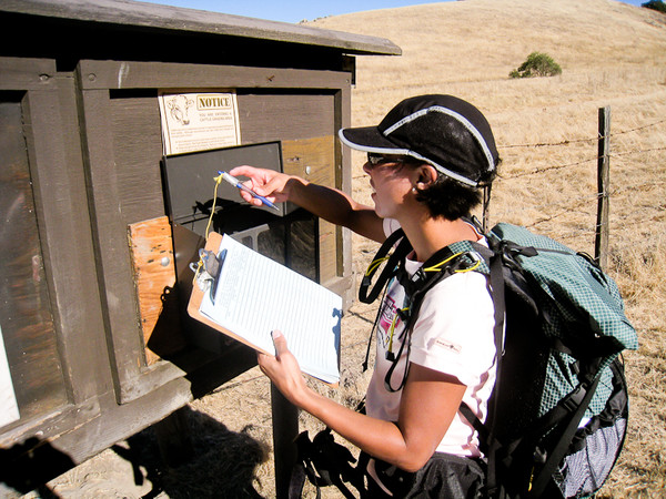 Registering at first backcountry sign board.